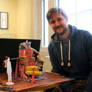 peter morton designer of dust with a model of the set lo res